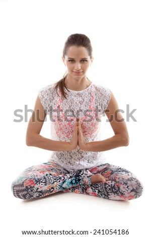 Yoga girl on white background in sukhasana (Easy Pose, Decent Pose, Pleasant Pose) vertical - stock photo