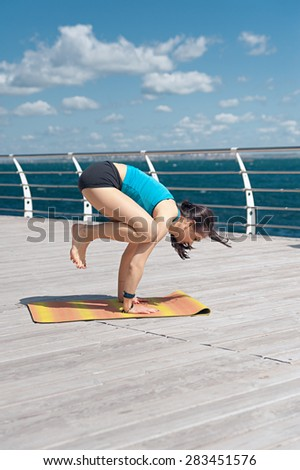 Yoga. Handstand on the sea background