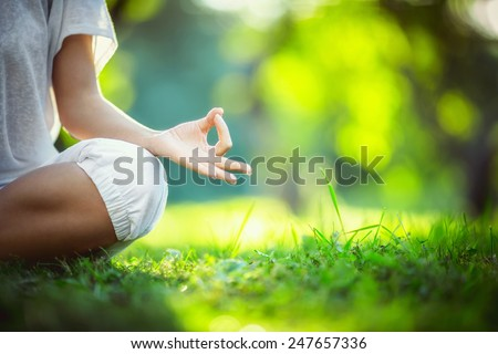 Yoga in the park - stock photo