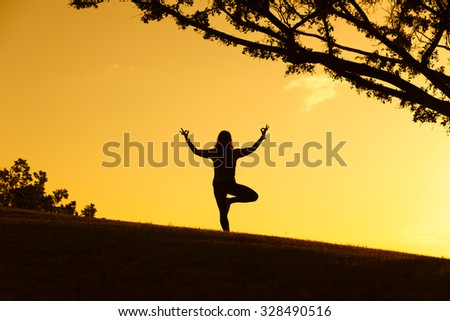 Yoga in the park. - stock photo