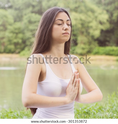 Yoga Meditating Relax Young Woman Outdoor. Healthy Lifestyle at beautiful summer day in nature.