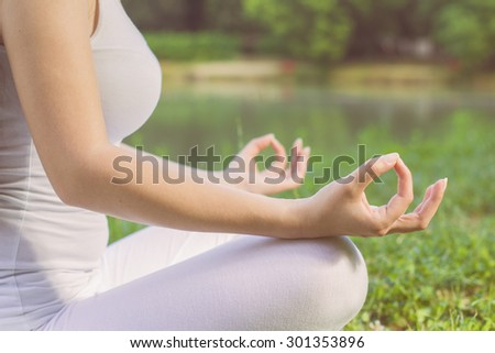 Yoga Meditating Zen Woman Relaxing Outdoor.Healthy Lifestyle in Lotus Posture .Unrecognizable caucasian female meditate. - stock photo