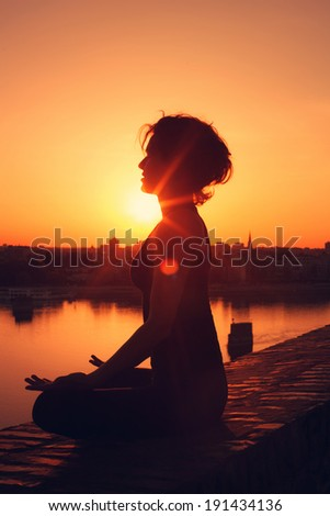 Yoga meditation  during the sunset  - stock photo
