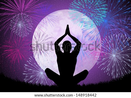 Yoga meditation in the night with fireworks - stock photo