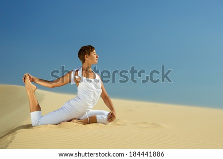 Yoga meditation on the beach, healthy female body in peace, woman sitting relaxed on sand over beautiful sea sunset, calm girl enjoying nature, active vacation lifestyle, zen spa, wellness concept - stock photo