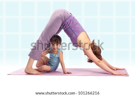 Yoga / Mother and her son doing yoga exercise - stock photo