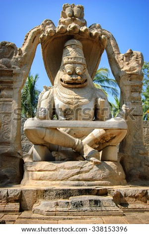 Yoga Narasimha form at a temple in Vijayanagara, Hampi, India. Visnu's incarnation as Narasimha is one of the most chosen themes and amongst perhaps next only to Rama and Krishna in popularity. - stock photo