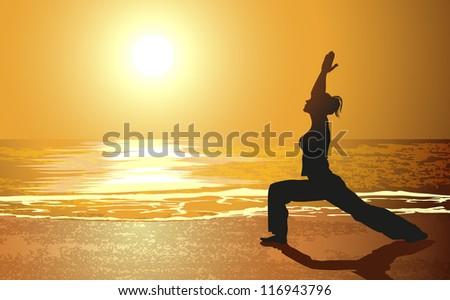 Yoga on a beach - stock photo