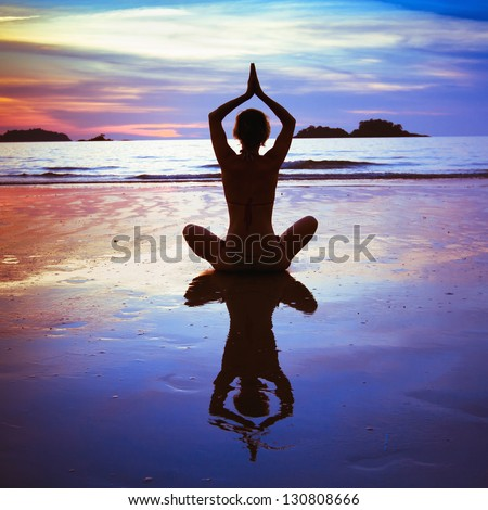 yoga on the beach, abstract photo about healthy lifestyle - stock photo