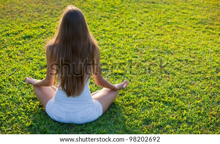 Yoga on the green grass - stock photo