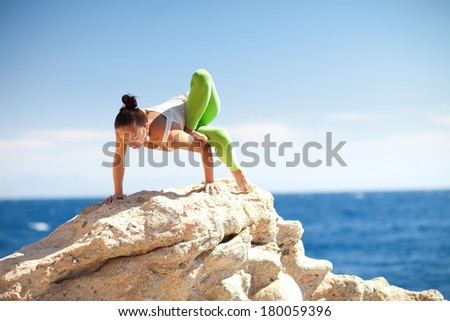 yoga on the mountain - stock photo