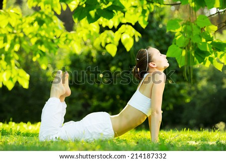Yoga outdoors. Concept of healthy lifestyle and relaxation - stock photo