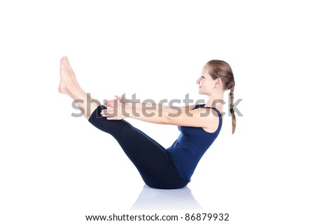 Yoga paripurna navasana boat pose by beautiful Caucasian woman in blue Capri and top at white background. Free space for text - stock photo