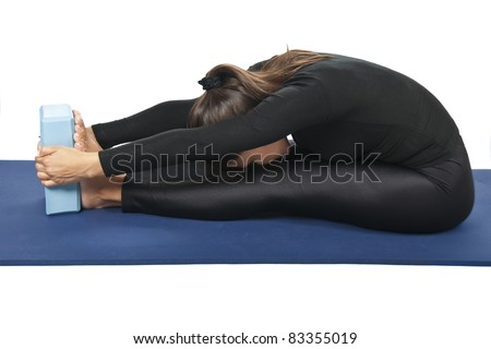 Yoga pose: Paschimottanasana (Seated Forward Bend or Intense Dorsal Stretch) - stock photo