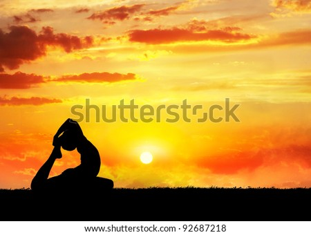 Yoga raja kapotasana pigeon pose by man silhouette at sunset sky background. Free space for text and can be used as template for web-site - stock photo