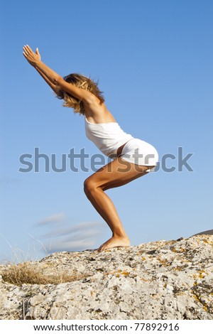 Yoga seria: Called Chair Pose - stock photo