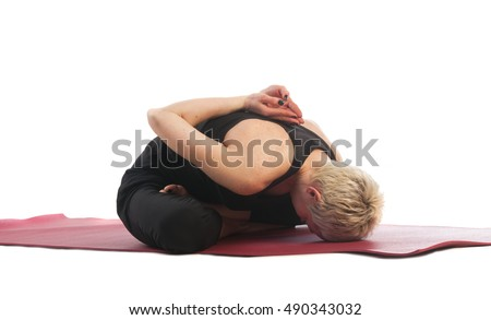 Yoga series: young woman in modificated yoga mudrasana Pose isolated on white background. Yoga Mudra, Yoga Mudrasana, Yoga Mudrasan, Yoga Mudra Asana, Yoga Mudra Asan is an asana