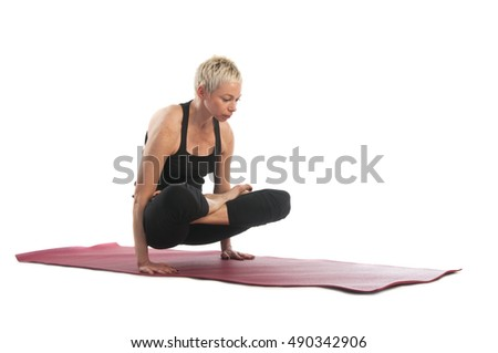 Yoga series: young woman in Tolasana yoga Pose (Scale Pose) isolated on white background