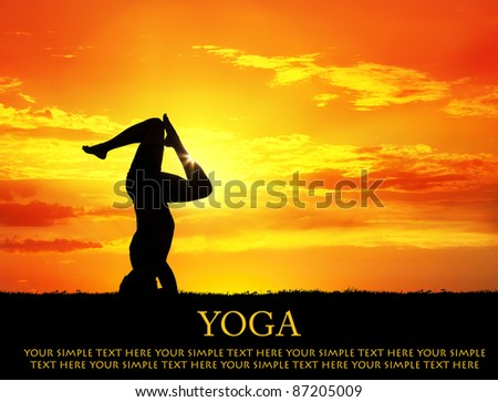 Yoga shirshasana head standing inverse pose with bending legs by Man in silhouette with orange sunset sky background. Free space for text and can be used for web-site - stock photo