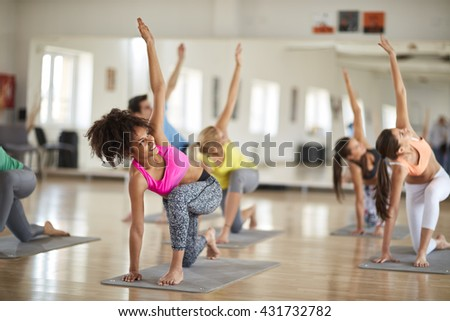 Yoga training in course indoor - stock photo