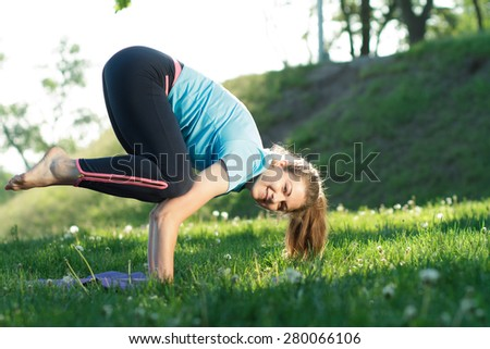 Yoga woman doing exercises in the park - stock photo