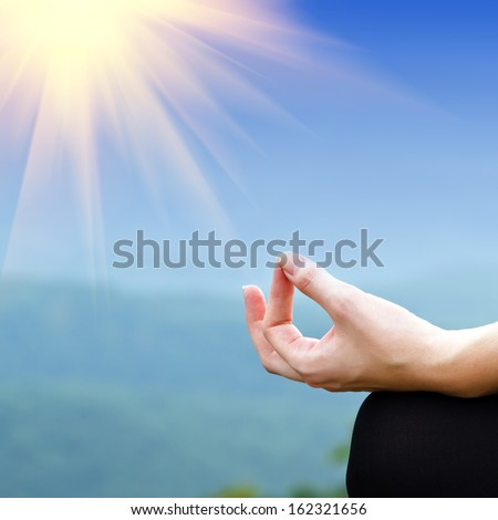 Yoga woman in lotus pose. Girl practicing yoga outdoors - stock photo