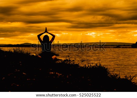 yoga woman meditate on sunset beach