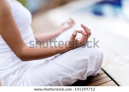 Yoga woman meditating and making a zen symbol with her hand - stock photo