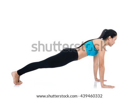 Yoga woman - pretty asian female in active wear doing yoga on white background
