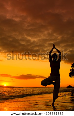 Yoga women silhouette, working on poses at sunset - stock photo