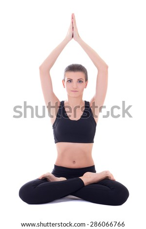 yoga - young beautiful woman sitting in lotus pose isolated on white background - stock photo