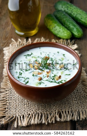 Yoghurt cold soup with cucumbers, nuts and dill, healthy diet food