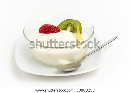 yoghurt with fresh fruit an a white saucer - stock photo