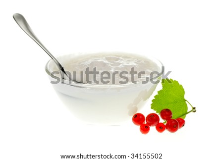 Yogurt bowl with spoon and Redcurrant berries on white background - stock photo
