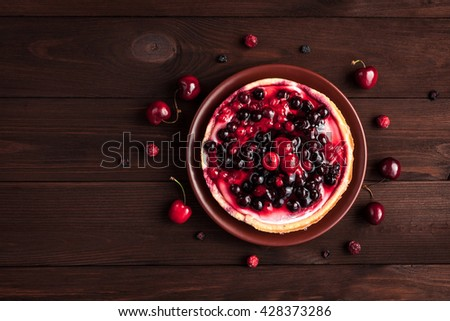 Yogurt dessert with berries. Summer dessert on wooden background. Top view, flat lay - stock photo