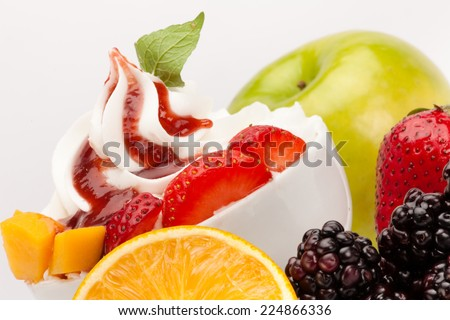 Yogurt ice cream with fresh fruits and marmalade - stock photo