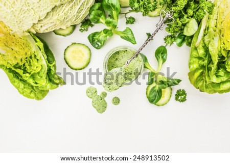 Yogurt smoothie  with green vegetables , food background, top view, frame - stock photo