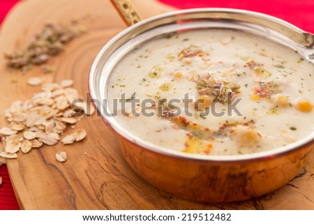 Yogurt soup with chickpea and oat meal - stock photo
