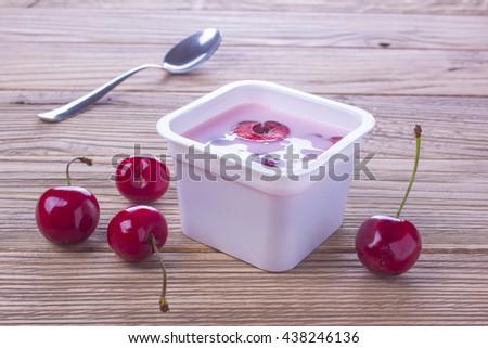 yogurt with fresh cherry - stock photo