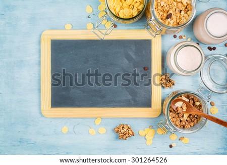 Yogurt with muesli  and vintage blackboard with copyspace - stock photo