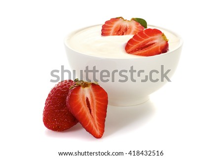 Yogurt with strawberries in bowl on white
