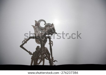 YOGYAKARTA, INDONESIA - AUGUST 14, 2012: Traditional Indonesian shadow puppet theatre wayang kulit performs on street during a religious festival in Yogyakarta, Central Java, Indonesia. - stock photo
