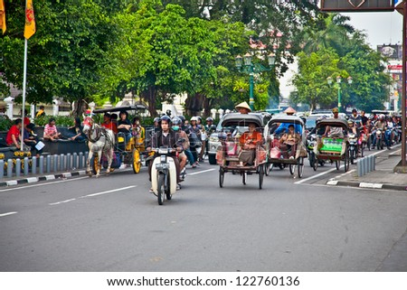 YOGYAKARTA, INDONESIA - JANUARY 3: View of Yogyakarta with its typical hundreds of motorbikes on January 3, 2012. in Yogyakarta, Indonesia. There is nearly 1 million of motorbikes in the whole city.