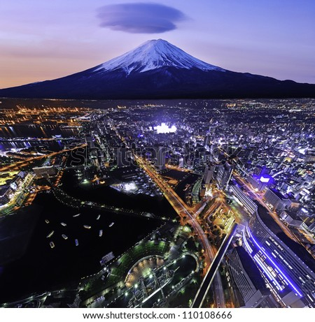 YOKOHAMA - AUG 4: Aerial view of harbor and Mt Fuji in Yokohama, Japan on Aug 4, 2012. With 3.6 million inhabitants Yokohama is a major commercial hub of the Greater Tokyo Area. - stock photo