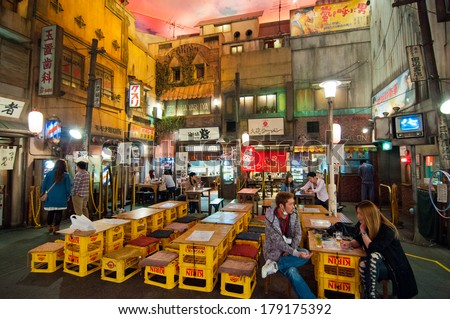 YOKOHAMA, JAPAN - APRIL 25 2012: Shin-yokohama Raumen Museum, devoted to Japanese ramen, features famous ramen dishes from all over Japan. The interior is a replica of old town in Tokyo in the 1950's. - stock photo