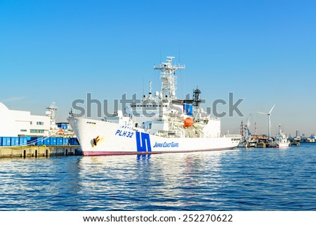 YOKOHAMA, JAPAN - February 11: Patrol vessel Akitsushima at Yokohama Base in Yokohama, Japan on February 11, 2015. It is the largest patrol vessel of the Japan Coast Guard.  - stock photo