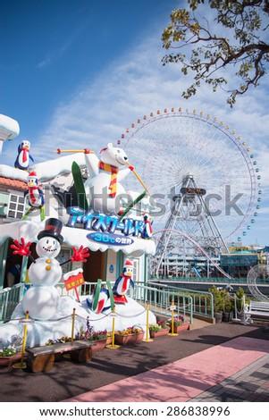Yokohama, Japan - March 04, 2015: Big wheel at Yokohama's Cosmo world amusement park, located in the heart of Yokohama. - stock photo