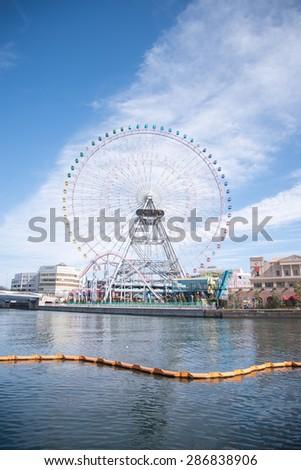 Yokohama, JAPAN - March 04 : Yokohama Minatomirai 21 district on March 04, 2015 in Yokohama, Kanagawa, Japan. Minatomirai is the central business district of Yokohama. - stock photo