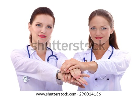Yomg woman doctor stacking hands together over white background . - stock photo