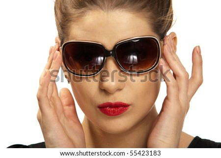 Yong, beautiful woman  wearing  big modern sunglasses. Studio shot on a white background [ isolated over white ]